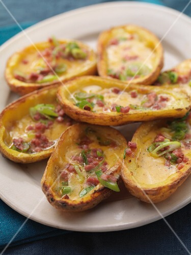 Baked potato skins with bacon and spring onions