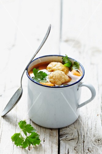 Vegetable soup in an enamel cup