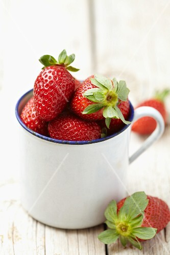 Strawberries in an enamel cup