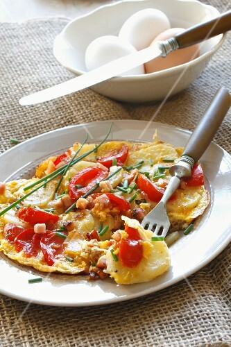 A farmer's breakfast with tomatoes