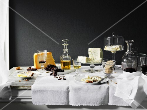 Wine, cheese and bread on a table