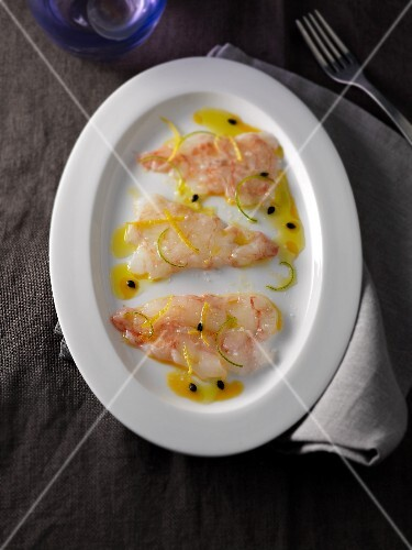 Carpaccio of scampi with passion fruit sauce