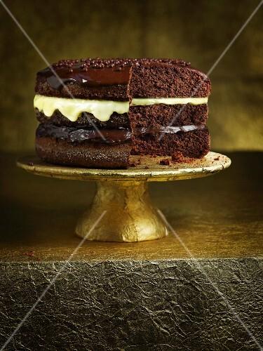 Three-layer chocolate cake on a cake stand