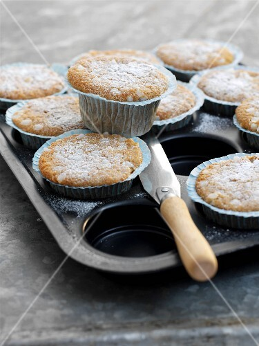 Apple and cinnamon muffins dusted with icing sugar