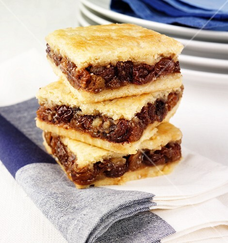A stack of pastry slices with dried fruit filling