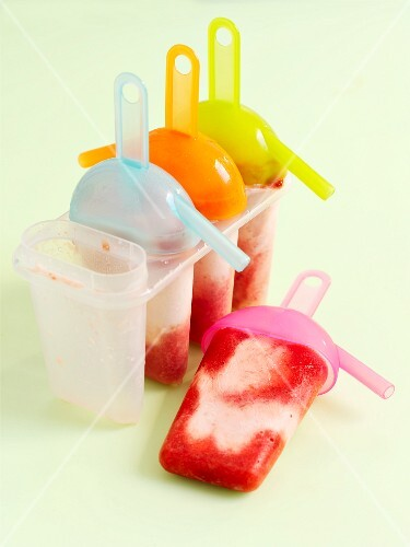 Home-made strawberry frozen yoghurt in ice-lolly moulds