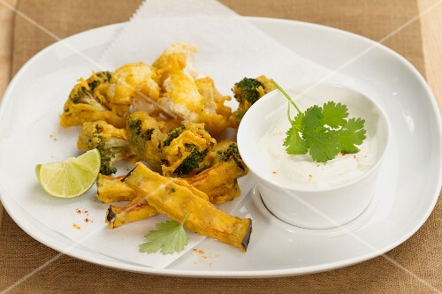 Pakoras (battered vegetables, India) with yoghurt dip