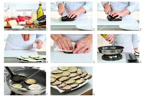 Sliced aubergines being fried