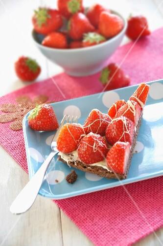 Piece of Chocolate Cake with Strawberry Garnish