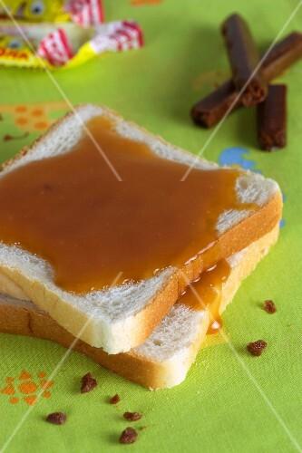 Sliced bread with caramel sauce