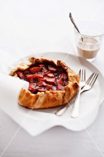 Strawberry galette with a cup of coffee