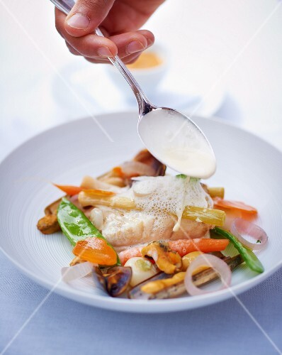 Turbot with vegetables and white sauce