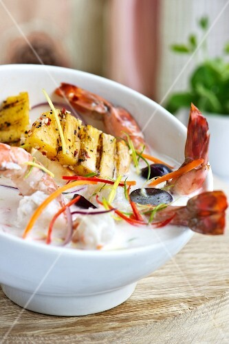 Grilled prawns and pineapple with coconut sauce