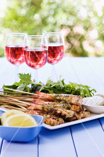 Grilled prawn skewers with garlic butter