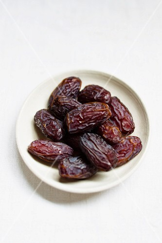 Medjool dates in a small bowl