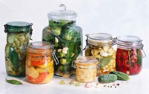Several jars of pickled vegetables