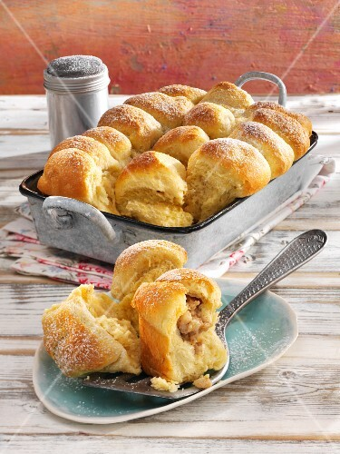 Buchteln (baked, sweet yeast dumpling) with pear and nut filling