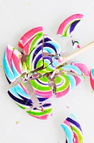 A Broken Swirled Lollipop; On a White Background