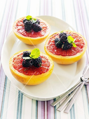 Pink Grapefruit Halves with Blackberries and Mint