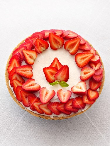 Frosted Cake Topped with Fresh Sliced Strawberries