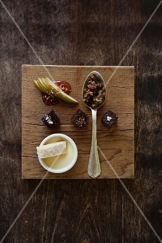 Dessert Sampler; Chocolate Boka Negra, Pistachio Brittle, Blood Orange Panna Cotta and Shortbread; All on a Cutting Board