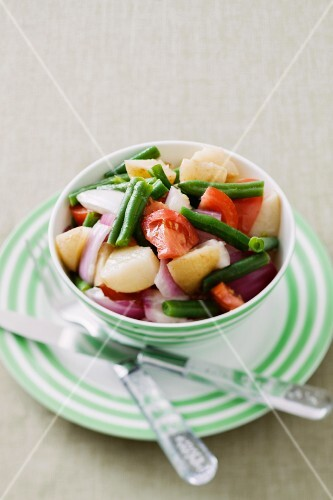 Vegetable salad with potatoes, beans, tomatoes and onions