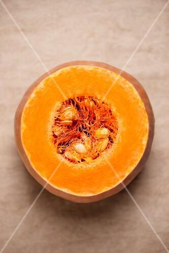 Cut pumpkin viewed from above. Soft focus.