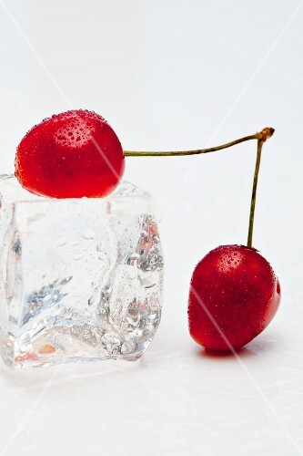 Red cherries with an ice cube
