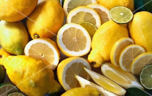 Whole lemons, halved lemons, slices and wedges of lemon