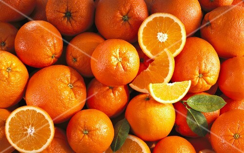 Oranges, whole and cut (filling the image)