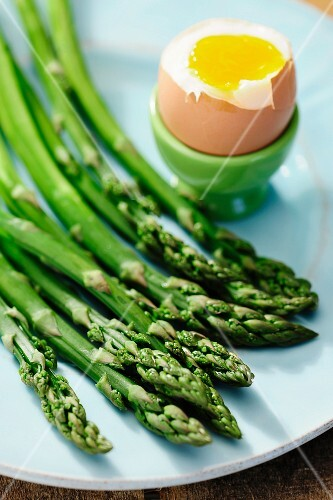 Cooked asparagus and soft boiled egg