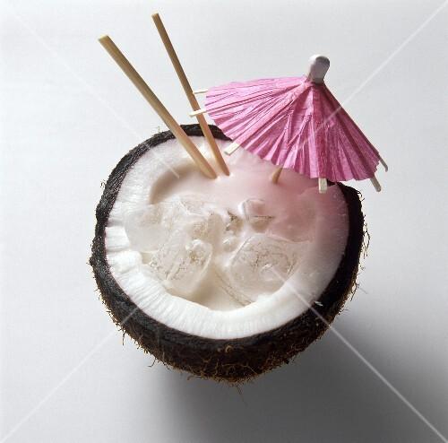 Pina Colada in a Coconut Half with a Cocktail Umbrella