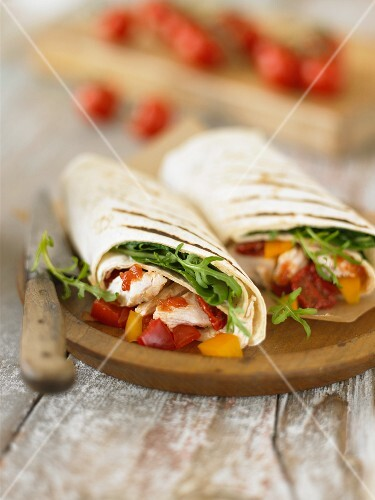 Wraps filled with chicken and peppers