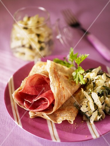 A pancake with ham and chard