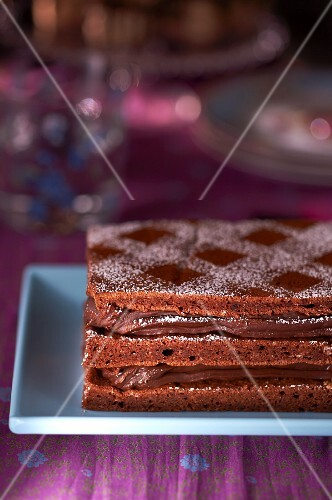 A layer cake with chocolate cream