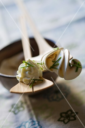 Raw mushrooms with cream and chopped chives