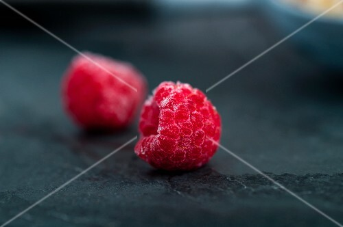Two frozen raspberries