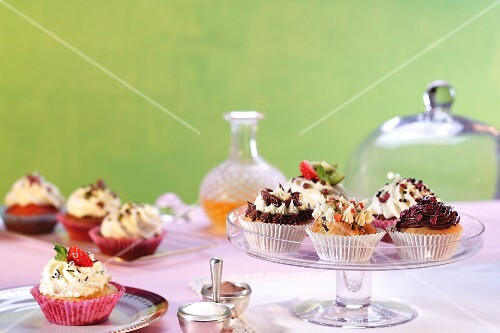 Assorted cupcakes on plates and cake stands