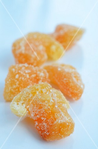 Pile of Candied Ginger on White Background