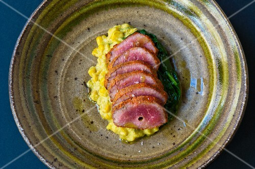 Roast lamb with spinach and sweetcorn