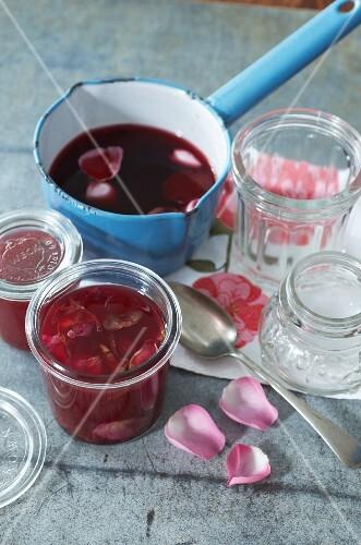 Rose jam in a preserving jar and in a saucepan
