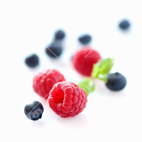 Raspberries and blackberries with no background