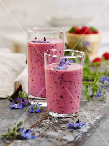 A berry and banana shake with apples and borage flowers
