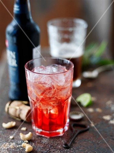 A red cocktail over ice