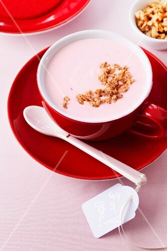 Yogurt with muesli in a red cup with a note