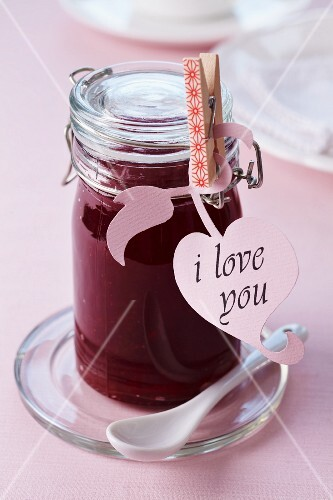 A jar of jam with an 'I love you' label