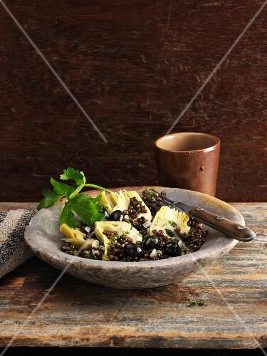 Lentil salad with artichoke hearts and black olives