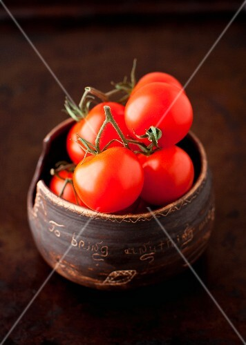 Fresh Cherry Tomatoes in a Small Brown Clay Bowl
