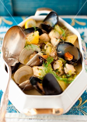 Mussel and Clam Stew with a Silver Serving Spoon