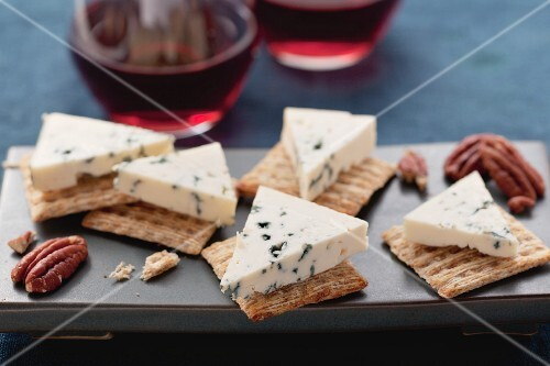Blue cheese, crackers, pecan nuts and red wine